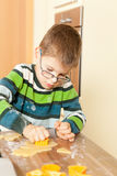 Little boy is baking. Family baking Christmas cookies in the kitchen Royalty Free Stock Image