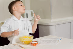 Little boy baking in the kitchen gives a thumbs up Royalty Free Stock Photography