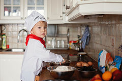 Little boy, baking muffins Stock Photo