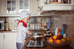 Little boy, baking muffins Royalty Free Stock Photography