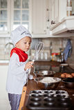 Little boy, baking muffins Stock Image
