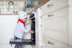 Little boy, baking muffins Stock Images