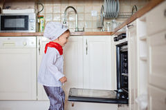 Little boy, baking muffins Royalty Free Stock Photo