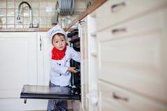 Little boy, baking muffins Stock Photography