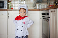Little boy, baking muffins Royalty Free Stock Images