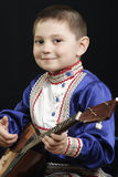 Little boy with balalaika Royalty Free Stock Images
