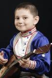 Little boy with balalaika Royalty Free Stock Images