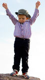 Little boy balanced on a rock Royalty Free Stock Photos
