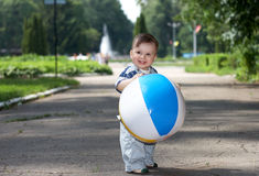 Little boy with ball. Little boy playing with a ball in the city park Royalty Free Stock Photos
