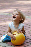 The little boy with a ball in hands Royalty Free Stock Photos
