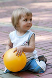 The little boy with a ball in hands Stock Photography