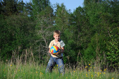 Little boy with a ball in the park Stock Images