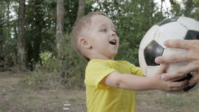 Little boy with a ball in the park stock footage