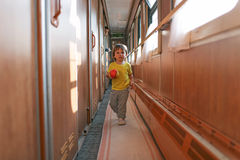 Little boy with ball in the train Royalty Free Stock Photos