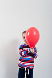 Little boy and balloon Stock Images