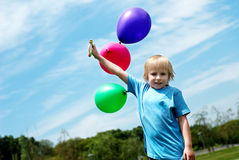 The little boy with balloons Stock Photo