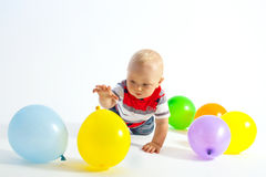 Little boy and balloons Stock Photos