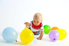 Little boy and balloons Stock Photos