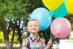 Little boy with balloons Royalty Free Stock Photos