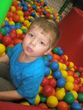 Little boy in balls Stock Photography