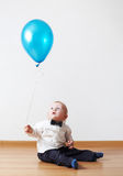 Little boy with baloon. Little boy plays with baloon royalty free stock image