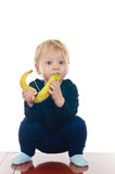Little boy with banana Stock Photography