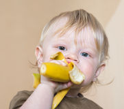 Little boy with banana Royalty Free Stock Images