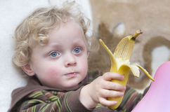 Little boy with banana Stock Images