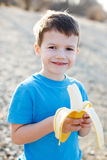 Little boy with banana Royalty Free Stock Photos