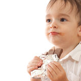 Little boy with bar of chocolate in his hands Stock Photos
