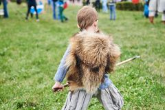 Little boy barbarian with a spear, from the back stock photo