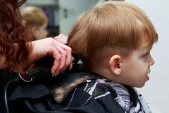 The little boy in the barber shop royalty free stock photos