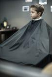 Little boy in barbershop Stock Image