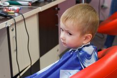 Little boy in barbershop. Getting head shaved Royalty Free Stock Images