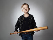Little boy with baseball bat.Funny child in leather coat.thug Stock Images