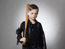 Little boy with baseball bat.Funny child in leather coat.thug. Little criminal boy with baseball bat.Funny child in leather coat.thug Royalty Free Stock Images