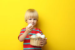 Little boy with basket of easter eggs Stock Photography