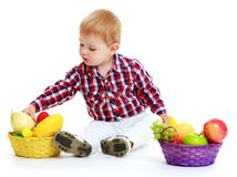 Little boy with a basket of fruit. Royalty Free Stock Image