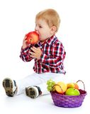 Little boy with a basket of fruit. Early years learning a happy childhood concept.Isolated on white background Royalty Free Stock Photos