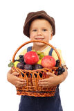 Little boy with basket of fruits Royalty Free Stock Image