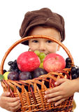 Little boy with basket of fruits Stock Images
