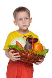 Little boy with a basket with vegetables Stock Images