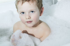 Little Boy in the Bath.Funny Child in Foam Royalty Free Stock Photo