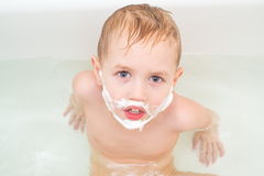 Little boy in bath with a mustache and a beard of Stock Photos