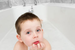 Little boy in the bath tub Stock Photos