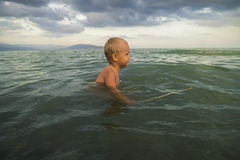Little boy bathes in the sea Royalty Free Stock Image