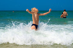 Little boy bathing on the sea. Summer joy. Little boy bathing on the sea royalty free stock photos
