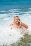 Little boy bathing on the sea Stock Photo
