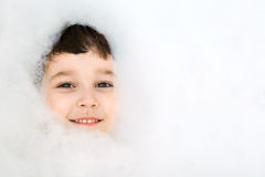 Little boy bathing in soapsuds Royalty Free Stock Images