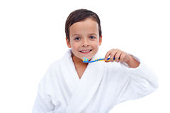 Little boy in bathrobe washing teeth Stock Photos